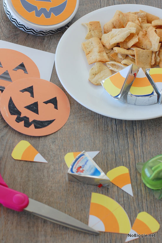 cheese wedges with a printable candy corn and jack-o-lantern tag are cute food for your Halloween party