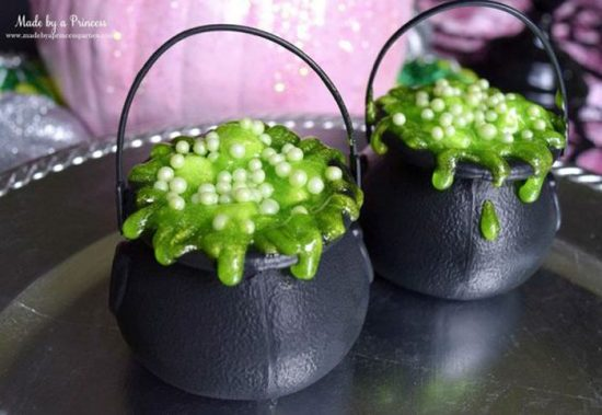Halloween pudding that look like potions brewing in a cauldron