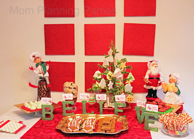Christmas cookies and milk buffet with letters spelline believe