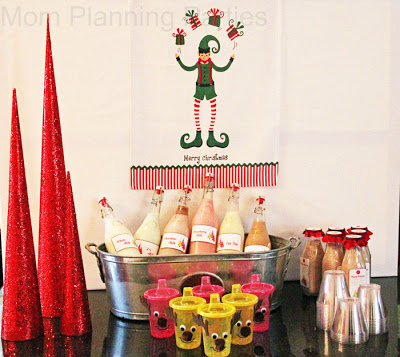 drink buffet with flavored milks in vintage style jugs and reindeer sippy cups