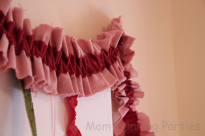 closeup of pink and red burlap ruffle garland