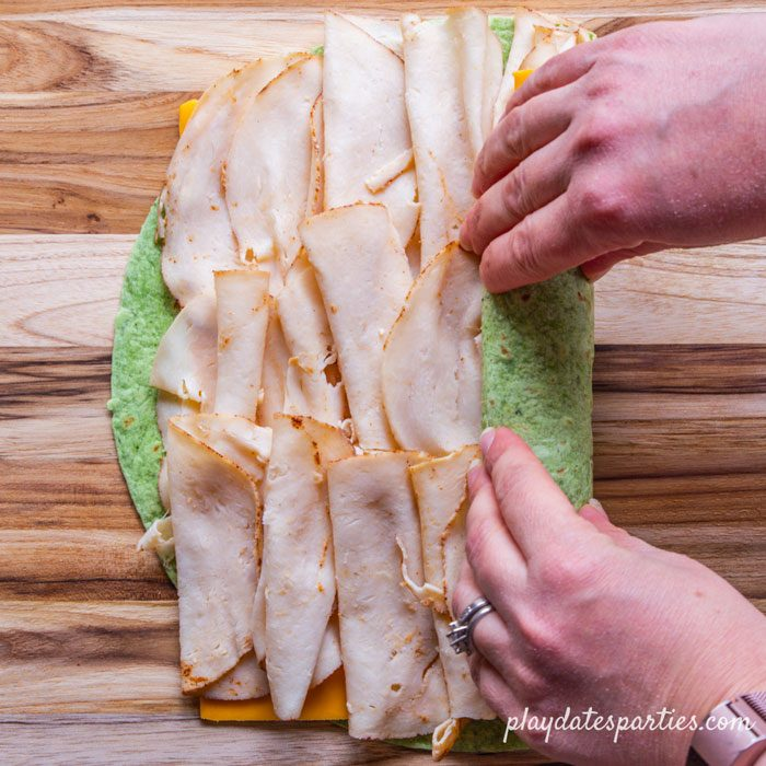 step 4 - rolling up the wrap and making sure the ingredients don't fall out
