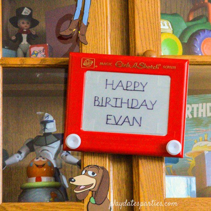 Etch a Sketch that says Happy Birthday Evan