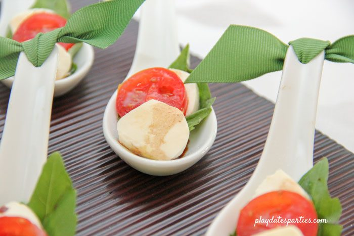 Mini caprese bites in appetizer spoons