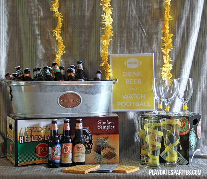 Take a look at this fun football kickoff party, including classic football fare. Don't miss the DIY chili toppings bar, hummus platter, Berger cookies, cornbread squares, and the craft beer bar.