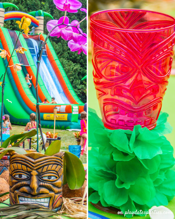 Luau party decorations including a tiki planter centerpiece with orchids, and tiki goblets wrapped in leis