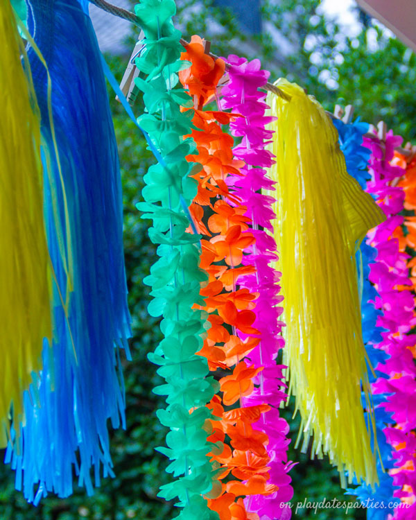 Colorful grass skirts and Hawaiian leis used as decorations for a luau party