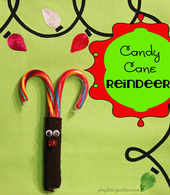 reindeer made with colorful candy canes wrapped with brown yarn and a red jingle bell nose