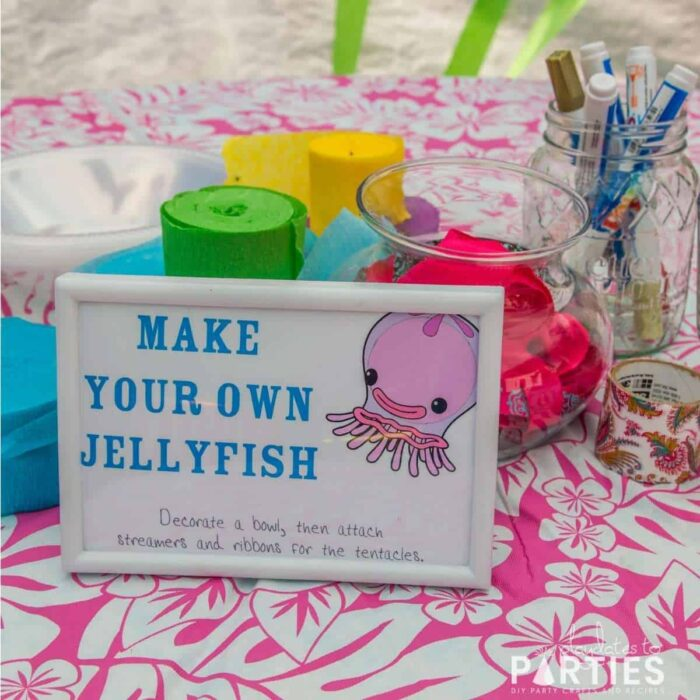 make your own jellyfish station with crepe paper streamers, ribbon, and paint pens