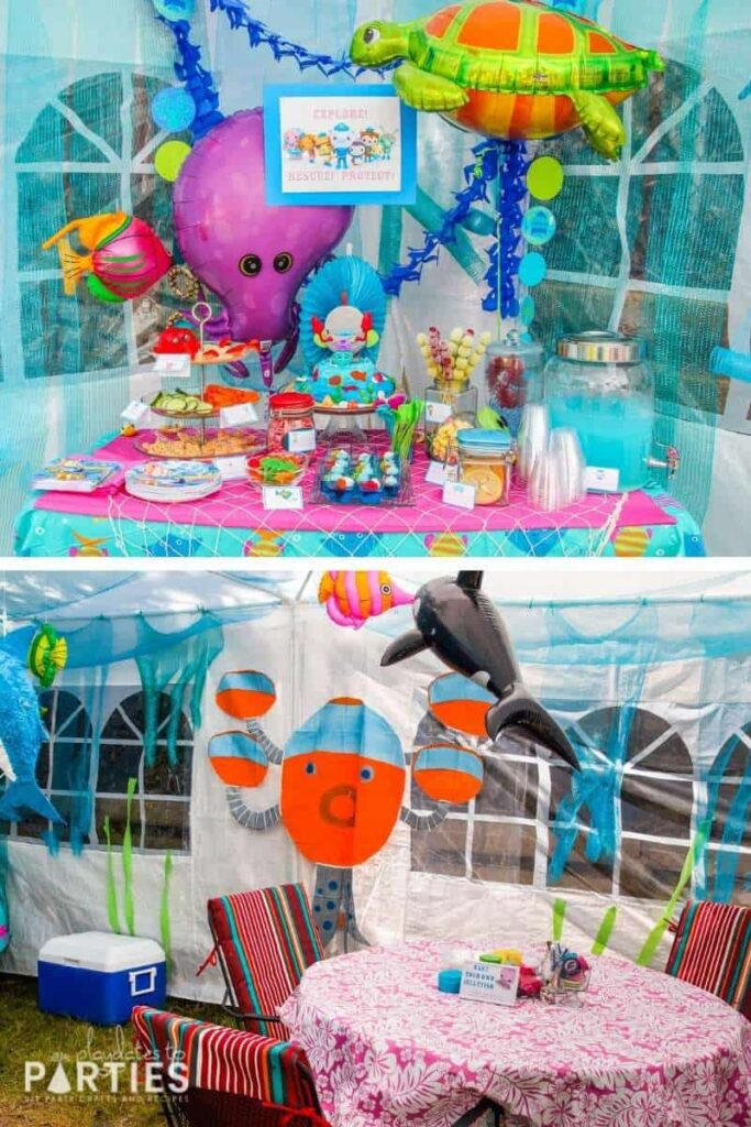 inside of a party tent decorated with ocean decor, including several sea creature balloons