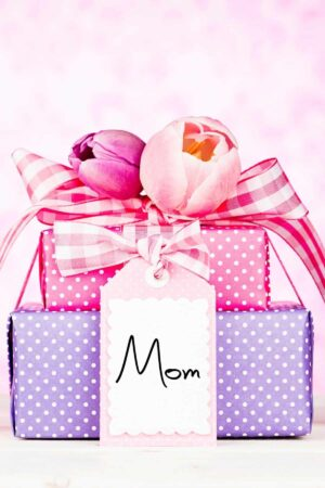gifts wrapped in pink and purple with a tag that says Mom