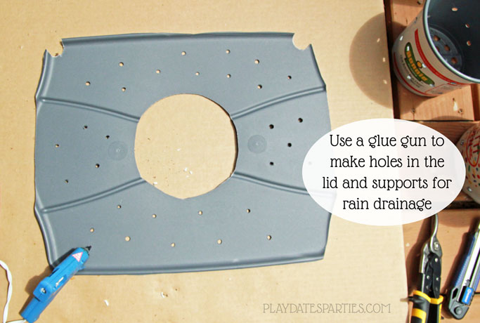 Make holes in the lid of the DIY self watering planter to allow rainwater to drain into the reservoir.