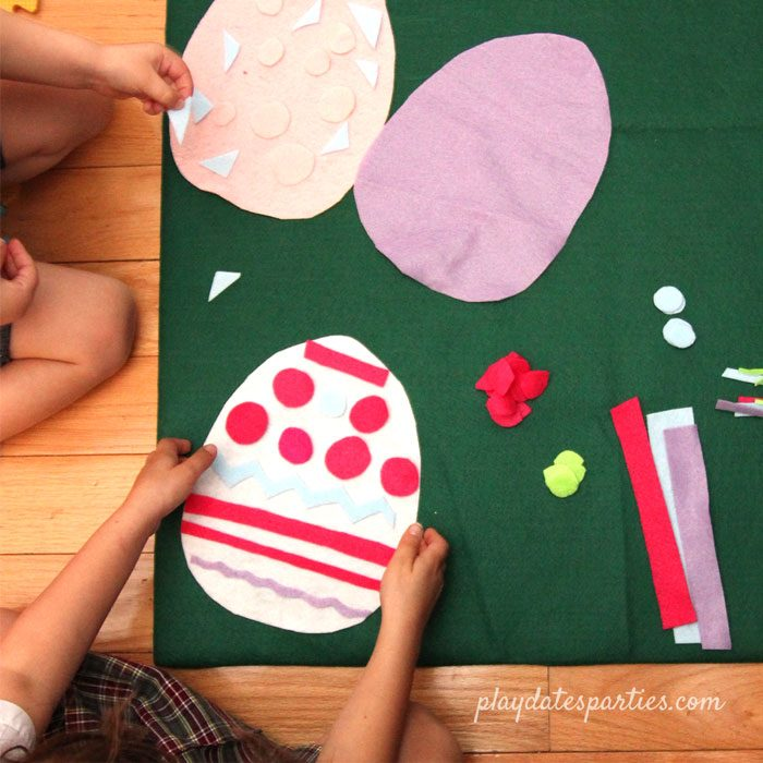 kids playing with felt Easter eggs