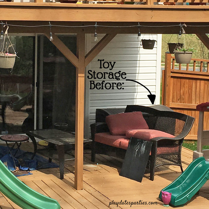 Outdoor toy storage in a resin box on a deck.