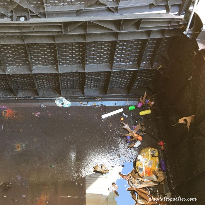 The dirty inside of a broken resin deck box