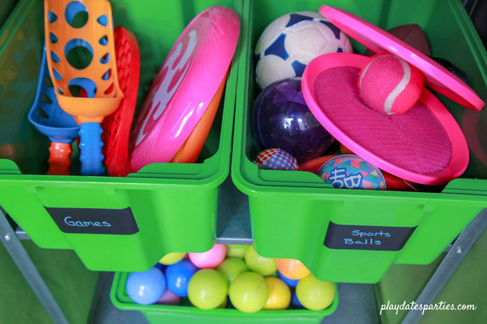 A look inside the small boxes and the outdoor toys that they hold, including balls, and outdoor games.