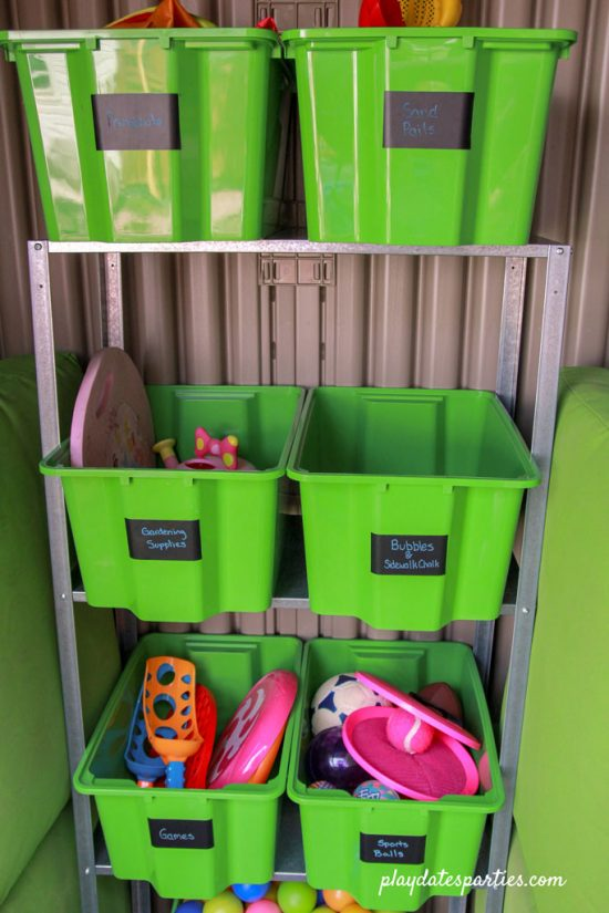 Using small boxes and metal shelving to hold outdoor toys