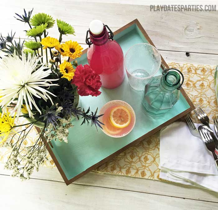 An unfinished tray gets a modern makeover with a natural stain on the outside and blue chalk paint on the inside.