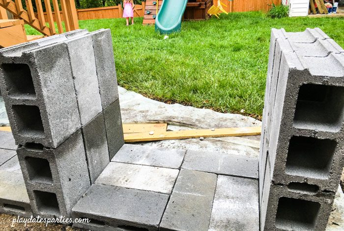 Cinder block legs and base for the DIY outdoor bar in place.