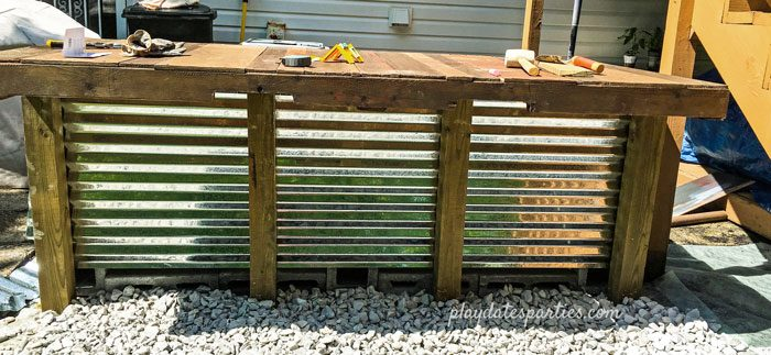 DIY outdoor bar with the corrugated steel front.