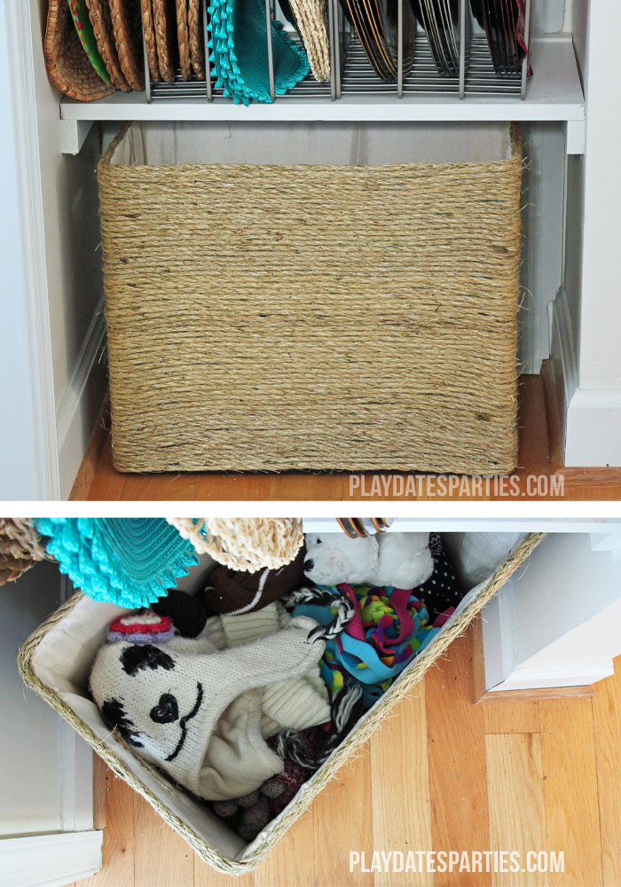 A DIY twine wrapped box provides a fantastic place to hide hats and mittens throughout the winter.