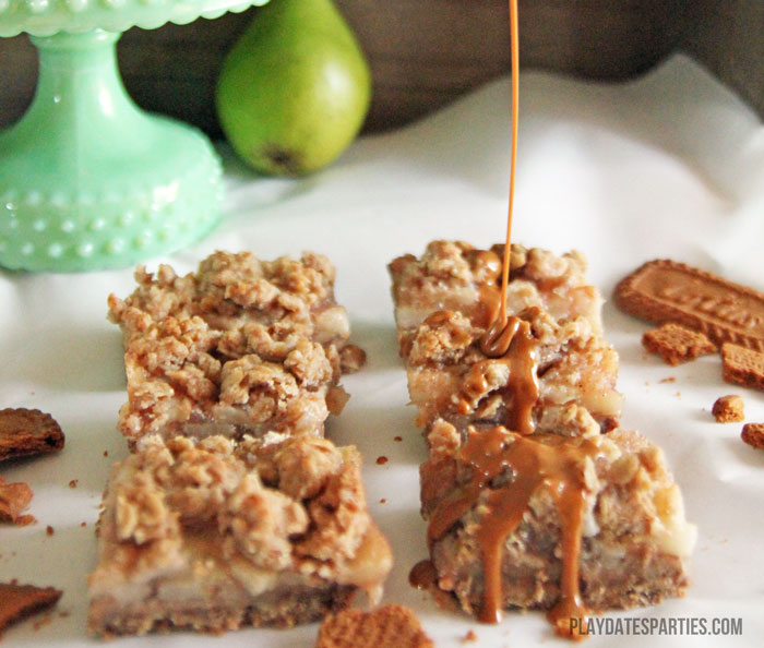 Drizzling cookie butter onto pear pie crumble bars.
