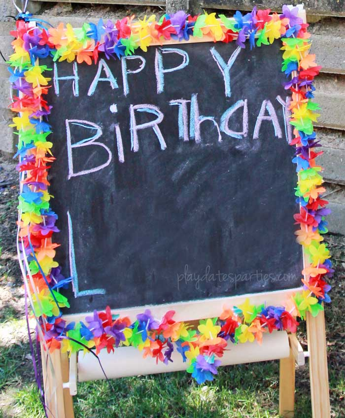 "A chalkboard easel with the words ""Happy Birthday"" written on them...a fun birthday tradition!"