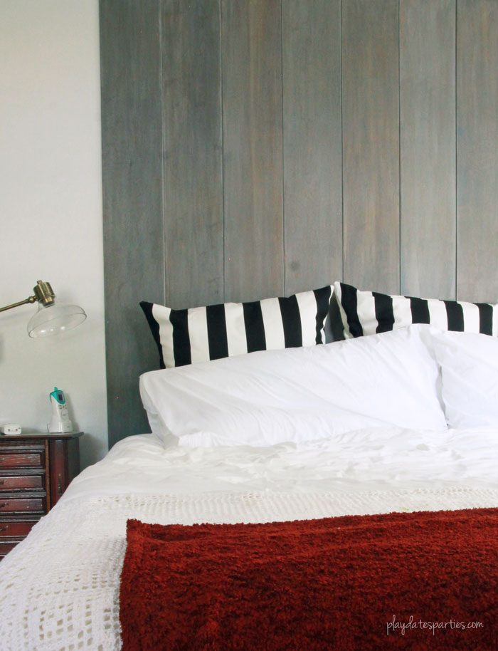 Can you completely change a room in just 6 weeks? In this master bedroom renovation week 5, things are finally coming together, including a sliding pocket mirror, faux vertical shiplap headboard, and a storage wall from multiple customized Ikea products.
