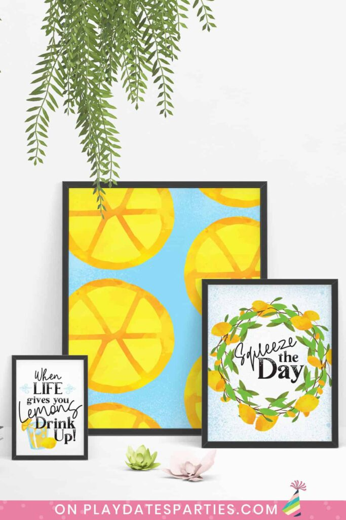 Three lemon art prints in black frames on a white floor in a variety of sizes