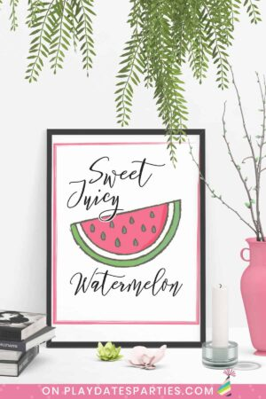Art print on a table that has a picture of a wedge of watermelon with the words sweet juicy watermelon