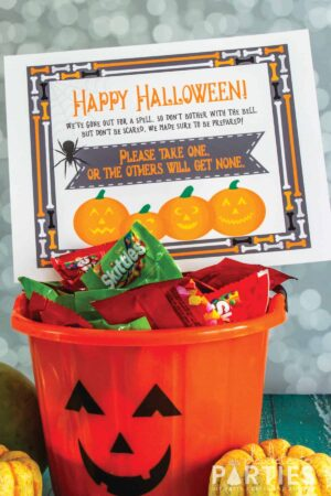 jack o lantern candy bucket with a Happy Halloween sign for kids to take one candy