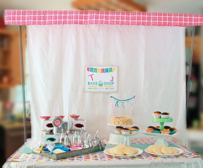Turn your island into a bake shop window with a DIY backdrop frame and plenty of ready-to-decorate cupcakes and cookies.