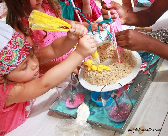 Let the kids all decorate a mini Rice Krispie cake at a baking birthday party!