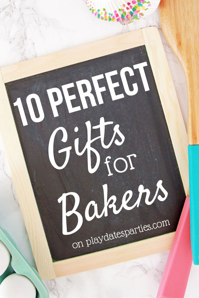 a picture of a chalkboard that says 10 perfect gifts for bakers with wooden spoons eggs and cupcake liners