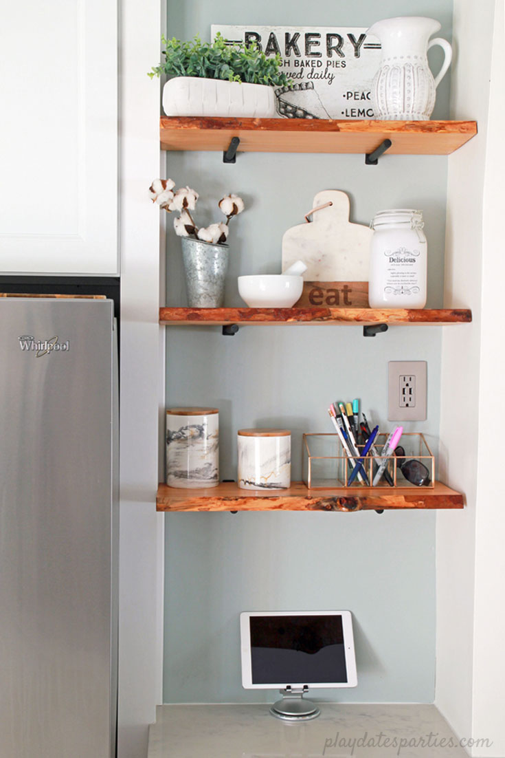 Turn an awkward space into prime real estate. The custom fit cabinet, #DIY live edge wood #shelves, and grey paint turned an eyesore into feature in the #design of this small white kitchen.
