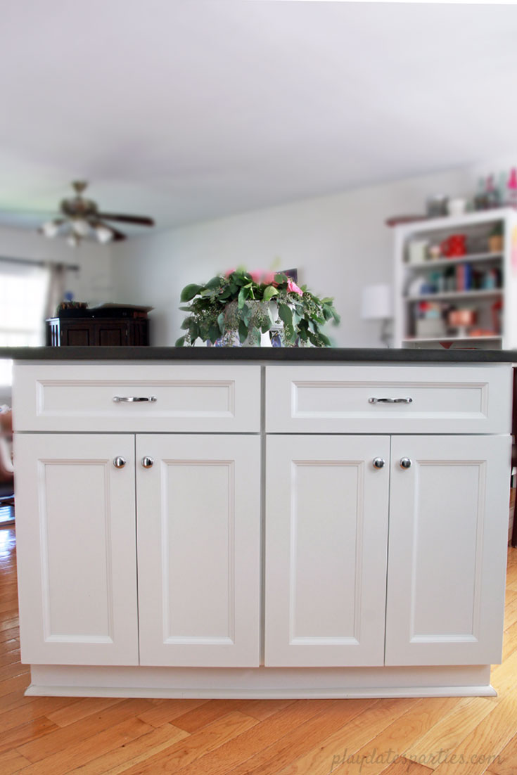 Big style can fit in #small spaces! Take a look at the before and after of this small white kitchen renovation. Including faux marble quartz countertops, #DIY wood shelves, light wood floors, and modern white tile for a clean and classic home #design.