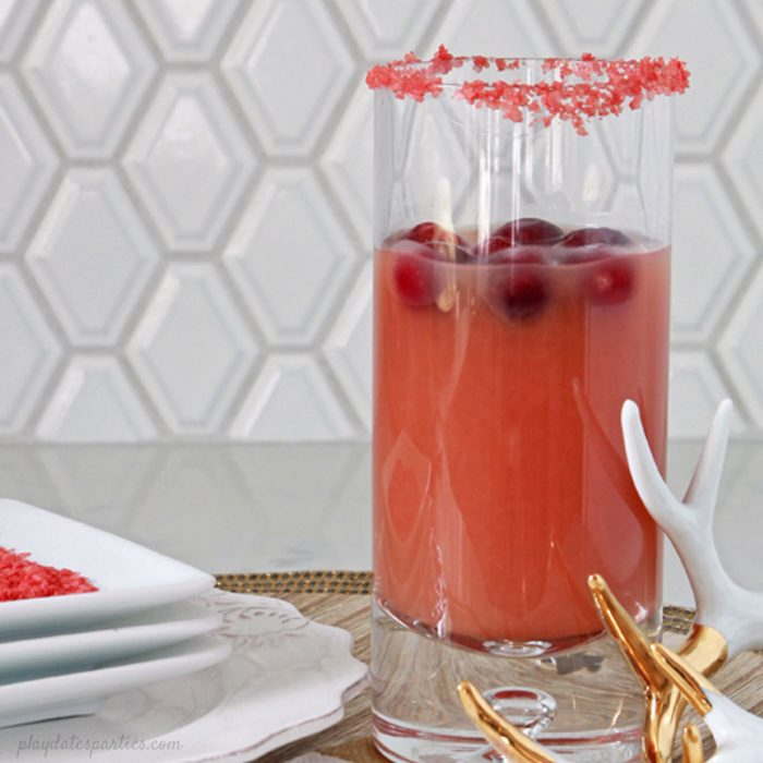 The Salty Dog cocktail gets a holiday update into the Salty Rudolph Cocktail, with cranberry, orange, the classic salted rim, and a surprising twist at the end. #Christmas #drinks #recipes