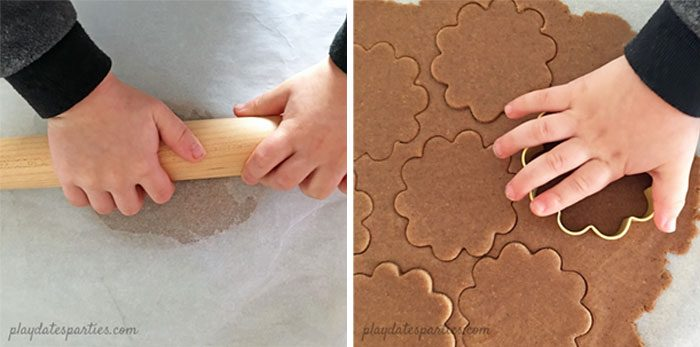 Image of toddler hands helping to roll out and cut homemade graham crackers.