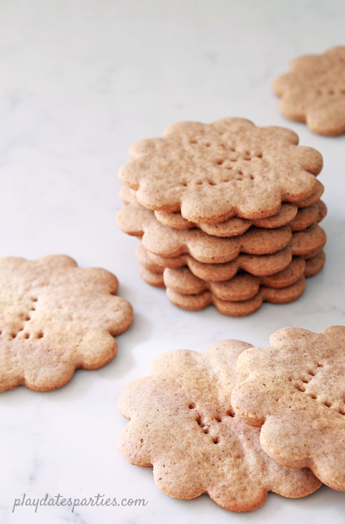 Stacks of baked flower shaped homemade graham crackers