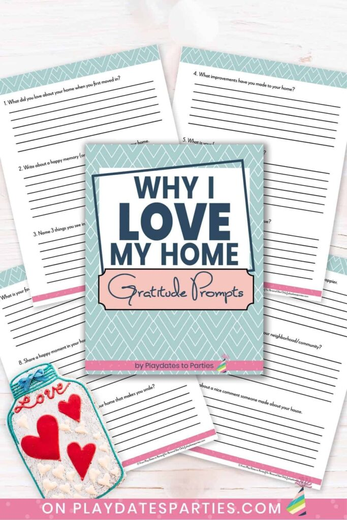 Mockup of pages from Why I Love My Home Gratitude Prompts Journal on a marble surface