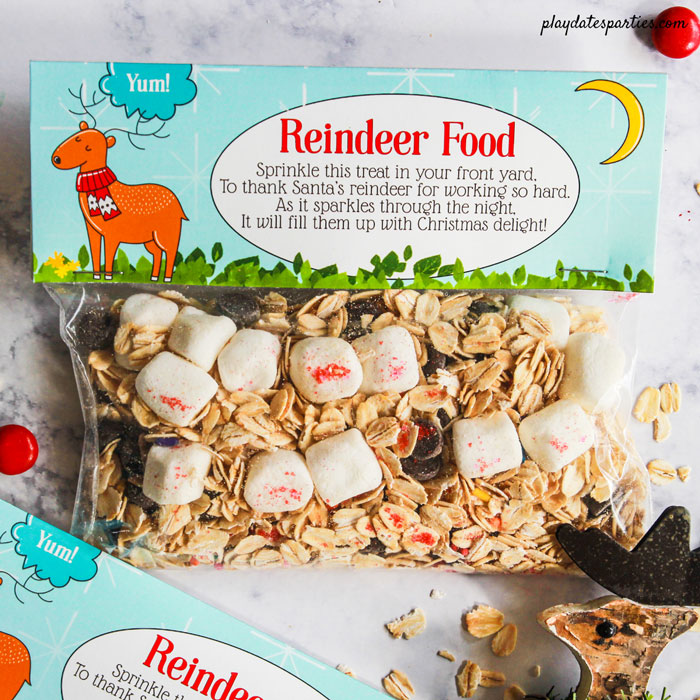 Reindeer Food printable bag topper with a bag full of oats, sprinkles, marshmallows, and chocolate chips