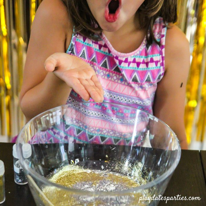 Showing off how much glitter is in this batch of clear slime recipe (no borax)