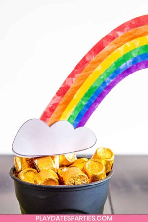 close up of a cup full of Rolos with a paper craft rainbow coming out of it