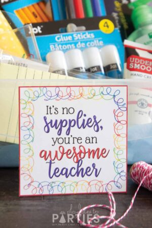 a box with school supplies and a gift tag that says it's no supplies you're an awesome teacher