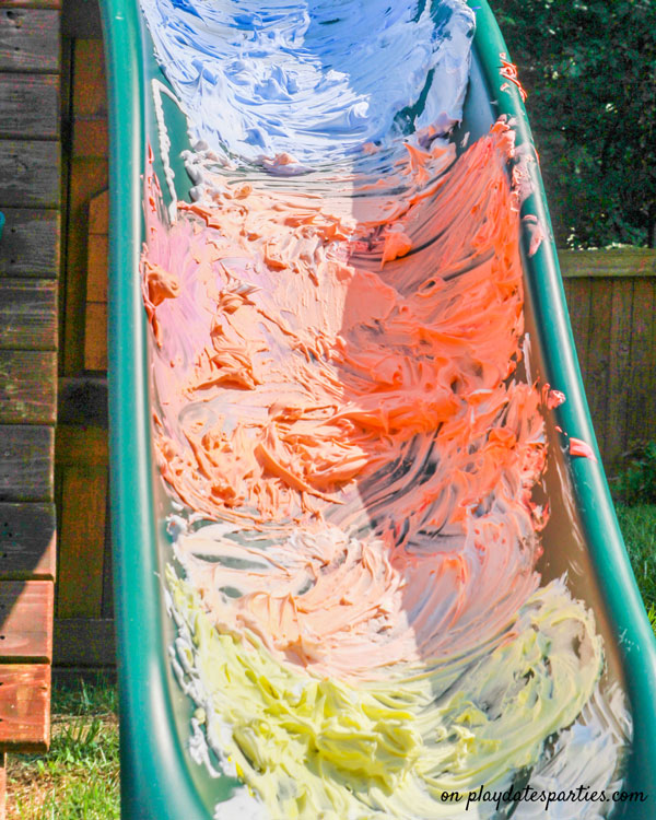 A slide covered with blue, orange, and yellow shaving cream