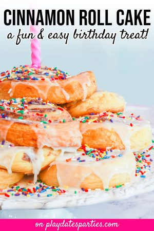Stacked cinnamon roll cake with sprinkles and a birthday candle and the text cinnamon roll cake a fun and easy birthday treat