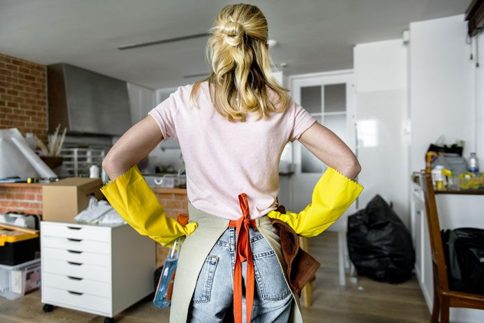 Woman preparing to clean a messy house before a party