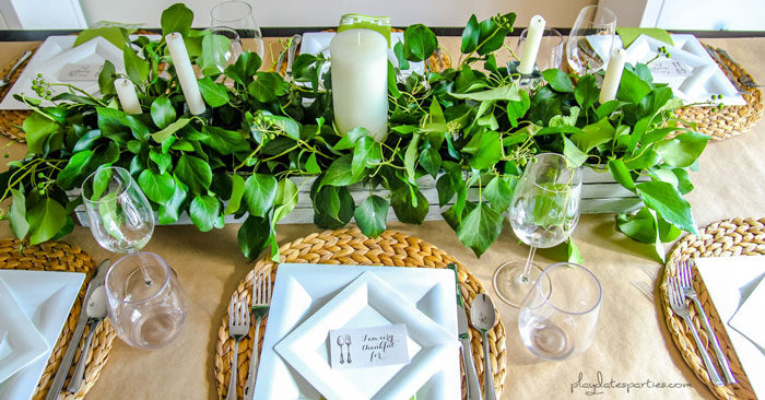 Inexpensive Thanksgiving table decor includes brown paper tablecloths, and reusable items such as woven placemats and wood boxes.