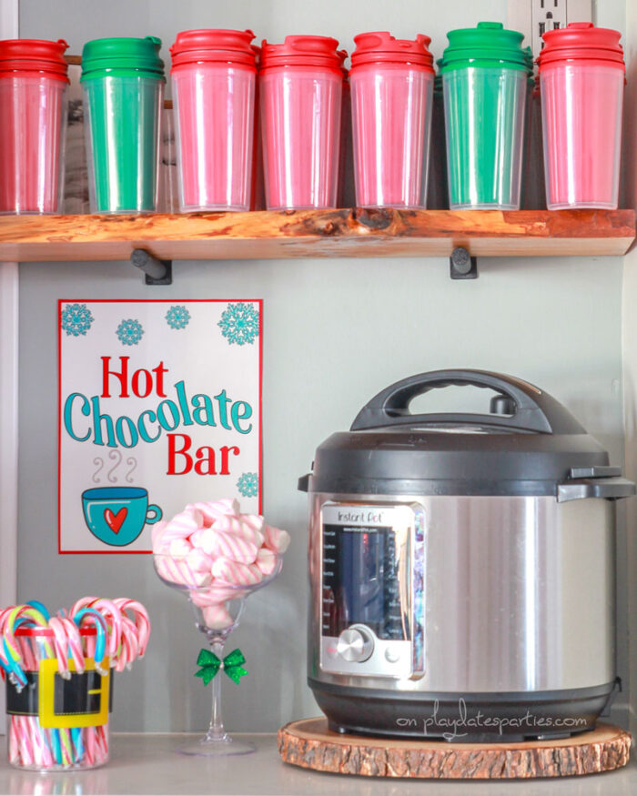 Hot chocolate bar with candy canes, marshmallows and dollar tree coffe mugs