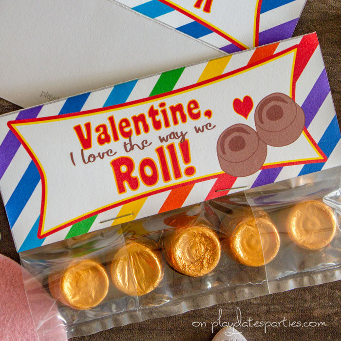 close up of treat bag topper with rainbow background and the text Valentine I love the way we roll